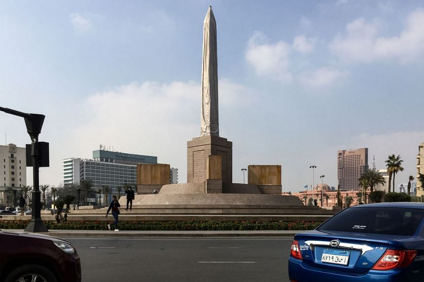 Above: Today, Tahrir Square has been spruced up, with an ancient obelisk the key feature of the revamp ordered by President Abdel Fattah al-Sisi. The transformation has erased traces of the 2011 revolution.