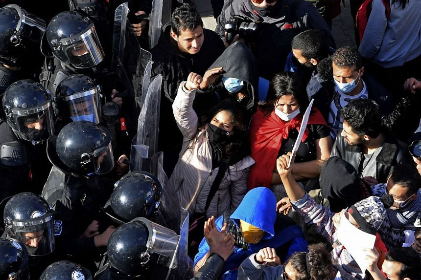 Tunisian police block protesters from accessing the parliament building on Jan 26, 2021 in Tunis.