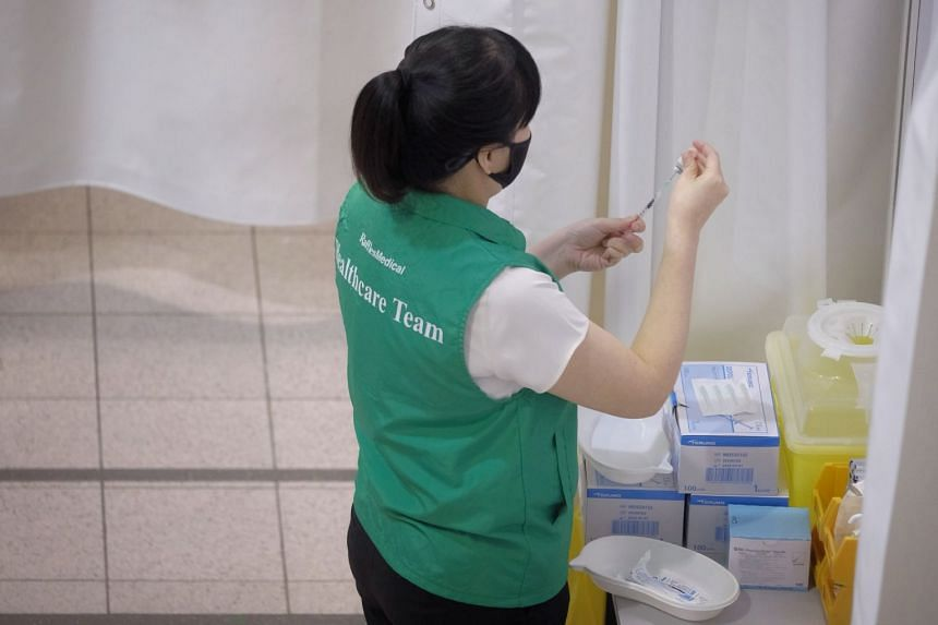 A nurse diluting the Covid-19 vaccine in a trial run at the vaccination centre in Tanjong Pagar Community Club, on Jan 26, 2021.