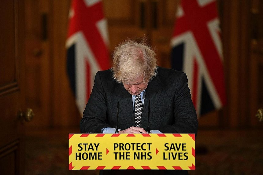 Johnson 'deeply sorry' as UK Covid deaths exceed 100000