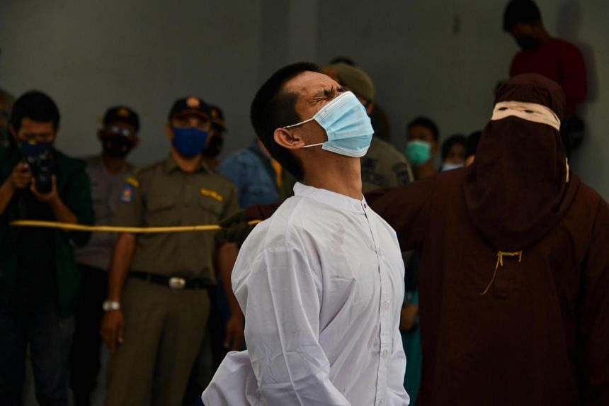 A man accused of having gay sex being caned in Banda Aceh on Jan 28, 2021.
