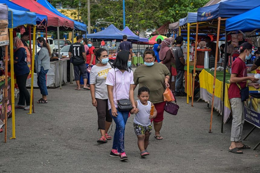 People visit a market in Pahang, Malaysia, on Jan 20, 2021.