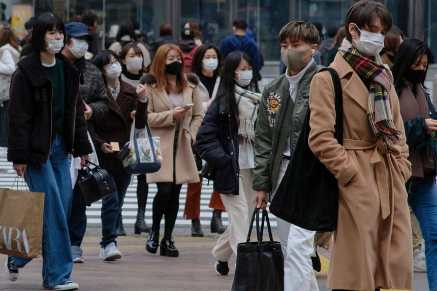 People in the Shibuya shopping and entertainment district in Tokyo, on Jan 17, 2021.