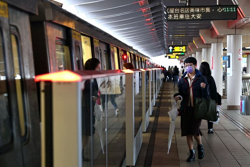 People wear protective masks to prevent the spread of the virus while riding the metro in Taipei, Taiwan, on Dec 23, 2020.