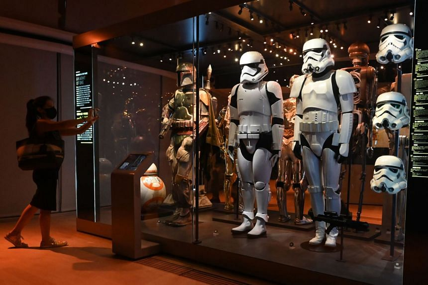 Life-sized figures of Stormtroopers from the Star Wars series displayed at the Star Wars Identities exhibition during a media preview at the ArtScience Museum in Singapore on January 28, 2021.