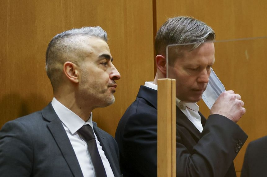 Stephan Ernst (right) takes off his mask in the courtroom as he waits for the verdict.