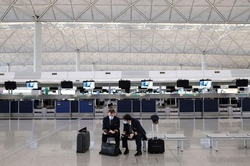 Pilots wearing face masks are seen at Hong Kong International Airport, in May 2020.