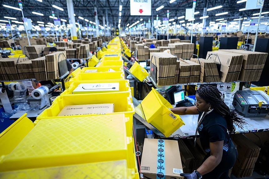 A worker at the Amazon fulfilment centre in Staten Island, New York City, in 2019. Enterprise Singapore is in talks with the e-commerce giant on training programmes to help local SMEs sell overseas via Amazon.