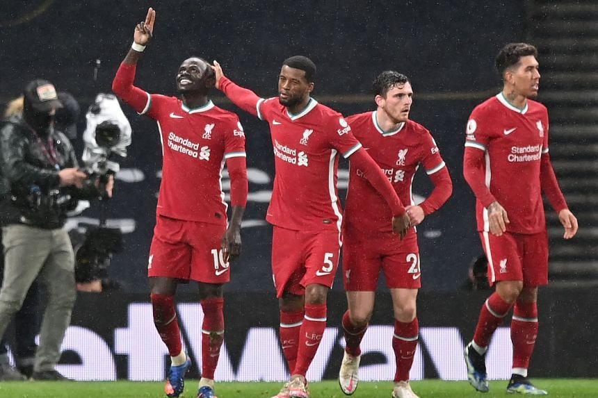 Sadio Mane (left) celebrates scoring Liverpool's third goal.