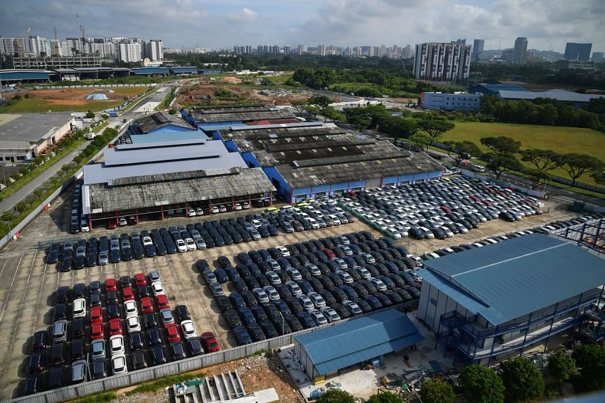 A massive industrial yard in Jurong housing an estimated 1,000 unused cars, including those previously owned by Uber's Lion City Rentals.