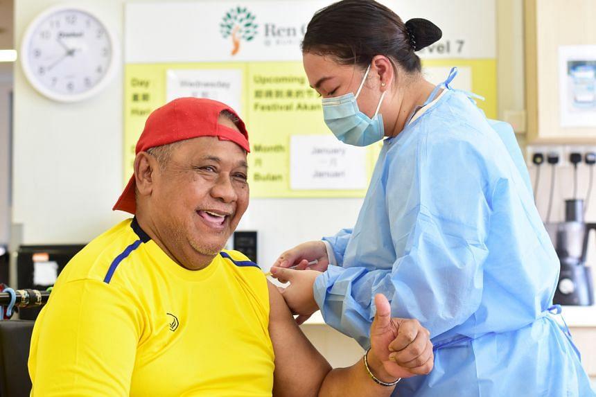 Ren Ci resident Abdul Majid Abdul Salam receiving the vaccine at the nursing home on Jan 20, 2021.