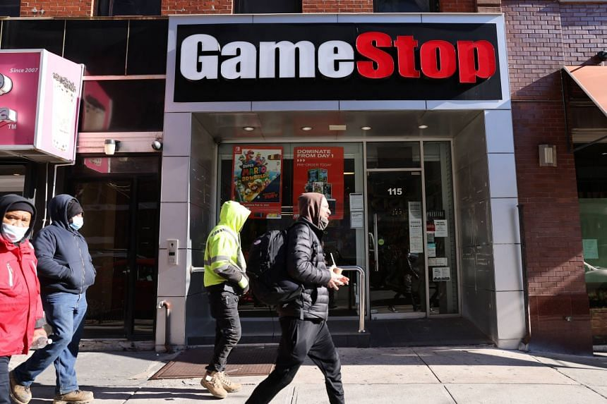 People walk by a GameStop store in Brooklyn on Jan 28, 2021 in New York City.