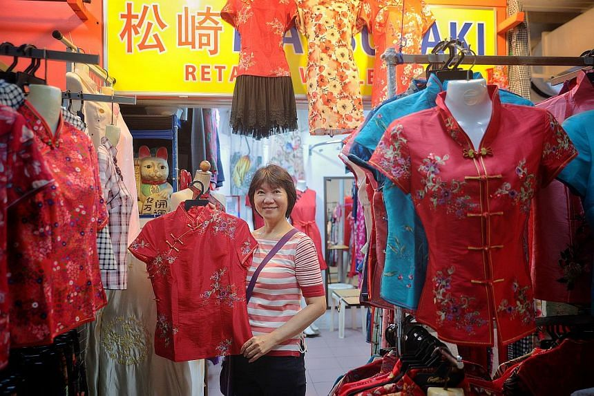 Ms Petrova Ang, owner of cheongsam shop Matsuzaki in Chinatown, is among those who will not be raising prices to avoid scaring off their customers.