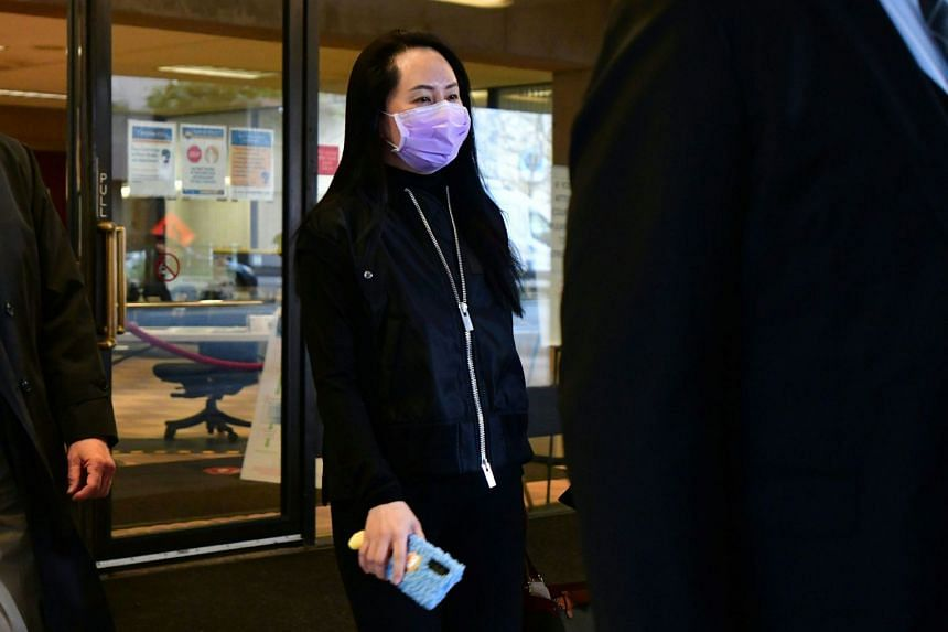 Meng Wanzhou leaves court, with her security detail in Vancouver, Canada, on Jan 29, 2021