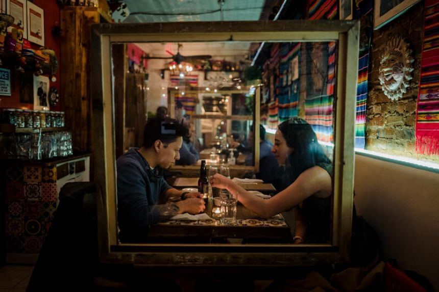 In New York, restaurant owners welcomed new rules that will allow them to resume indoor dining at 25 per cent of capacity.