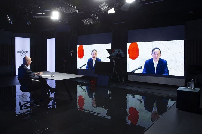 World Economic Forum founder and chairman Klaus Schwab watching Japanese Prime Minister Yoshihide Suga speak during a videoconference yesterday at the Davos Agenda in Cologny, near Geneva, Switzerland.