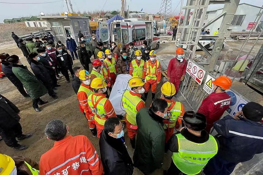 Rescuers carrying a miner on a stretcher at the gold mine in Qixia, China's Shandong province, after he was saved on Jan 24 - two weeks after a mine shaft collapsed, trapping him and 21 others. Local officials sat on the news for nearly 30 hours befo