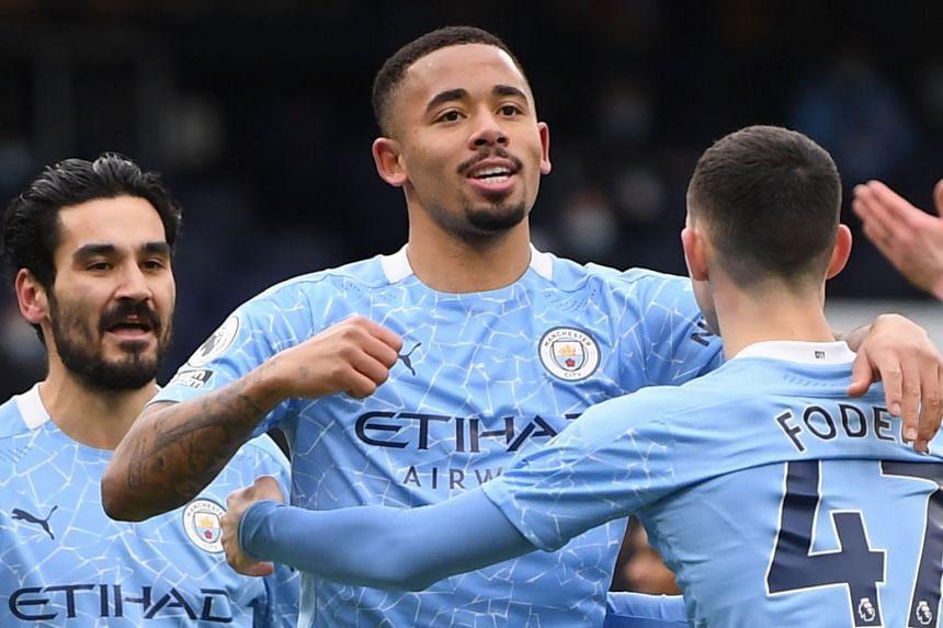 Gabriel Jesus (centre) celebrates scoring for City.