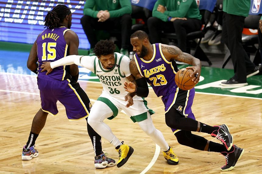 The Lakers' LeBron James (right) drives to the basket past the Celtics' Marcus Smart during their game in Boston on Jan 30, 2021.