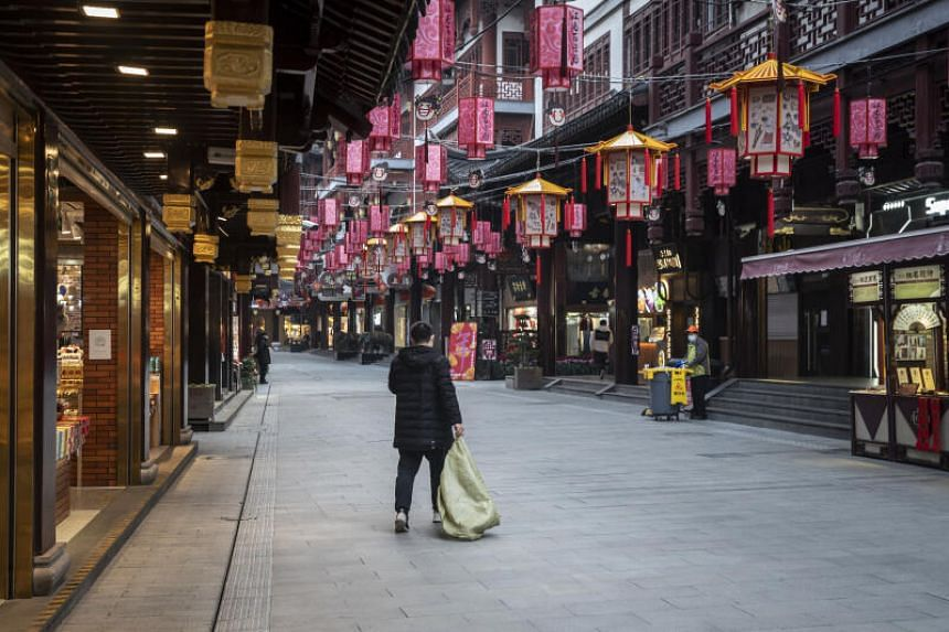 A person walks through the near-empty Yuyuan Bazaar ahead of Lunar New Year in Shanghai, on Jan 27, 2021.