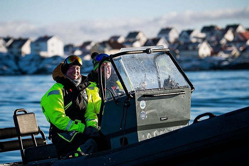 Nurse Lisa Enroth (above, left), who is a Covid-19 front- liner, on her way to Hamneskar island, off Sweden's west coast, on Saturday. The film buff was picked from more than 12,000 candidates who had applied to watch the Gothenburg film festival's m