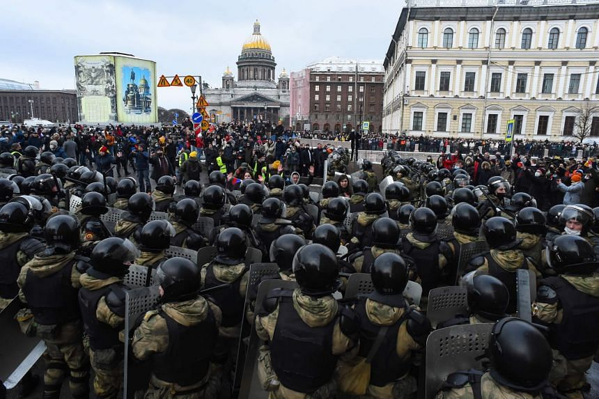 Law enforcement officers block protesters during a rally in support of jailed opposition leader Alexei Navalny in St Petersburg, on Jan 31, 2021.