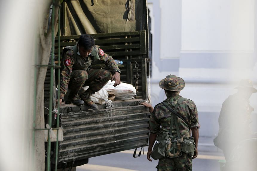 Military soldiers move bags from a truck into Yangon City Hall on Feb 1, 2021.