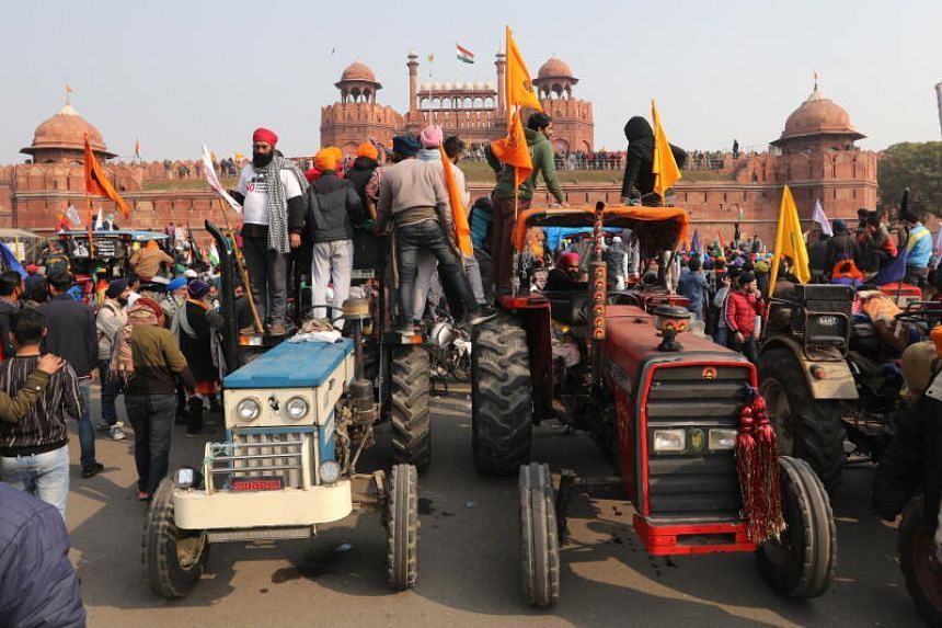 Farmers protesting at New Delhi's Red Fort on Jan 26, 2021.
