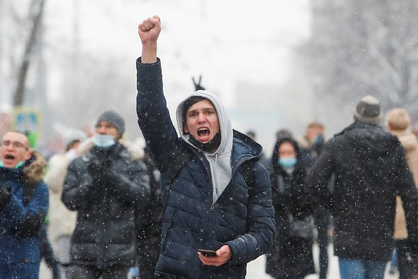 A protester raises his fist during a rally in support of jailed Russian opposition leader Alexei Navalny in Moscow, on Jan 31, 2021.