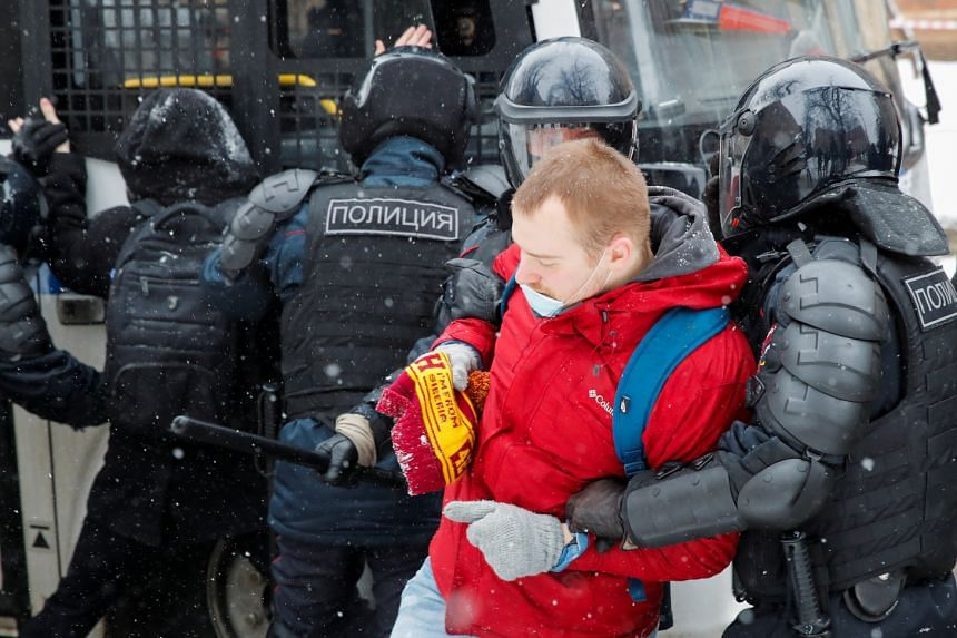 Officers detain a protester during a rally in support of jailed Russian opposition leader Alexei Navalny in Moscow, on Jan 31, 2021.