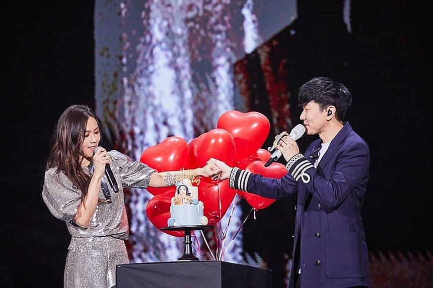 Tanya Chua and JJ Lin (both left) performed a song he wrote, Practice Love, after which he surprised her with a tiered cake and balloons.