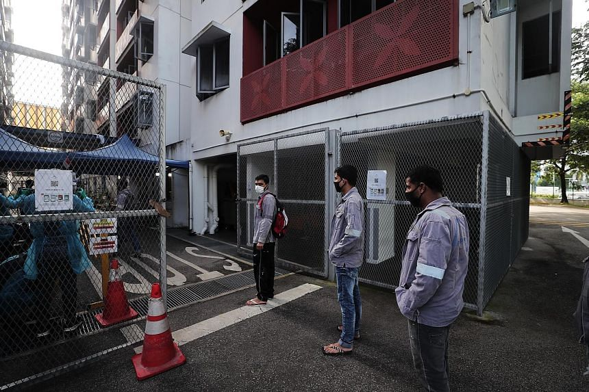 Vaccination will be made available to migrant workers in dormitories as part of the strategy to protect all Singaporeans and long-term pass holders here, said Second Minister for Manpower Tan See Leng. ST PHOTO: KELVIN CHNG