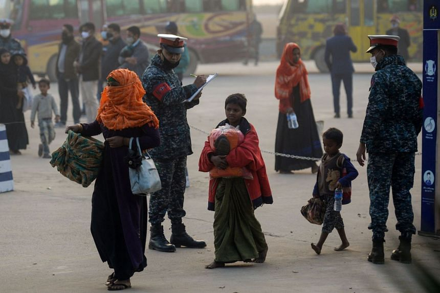 Rohingya refugees make their way to a Bangladeshi navy ship in Chittagong, on Jan 30, 2021.