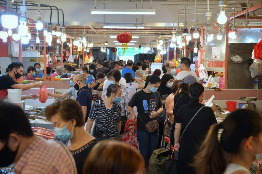 Shoppers throng the seafood section at Chinatown Wet Market on Feb 2, 2021.