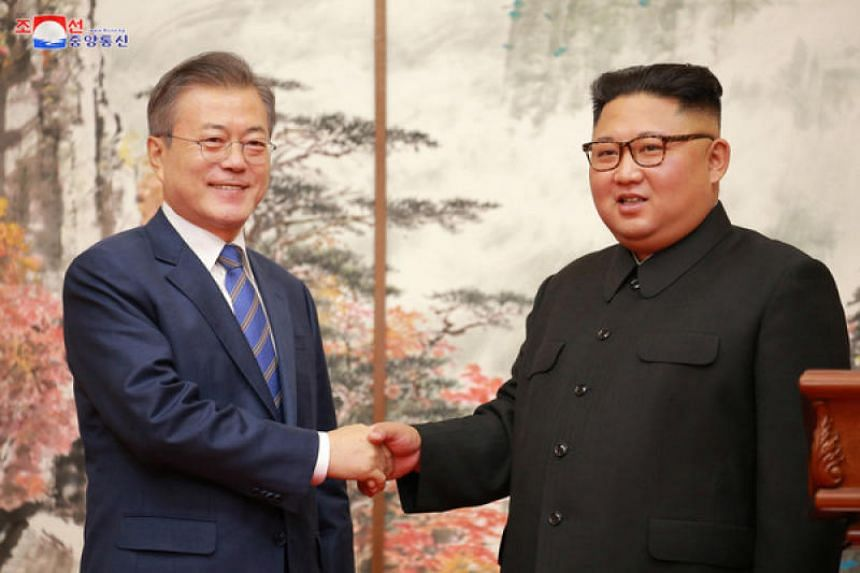 South Korean President Moon Jae-in and North Korean leader Kim Jong Un shake hands during their joint news conference in Pyongyang on Sept 19, 2018.