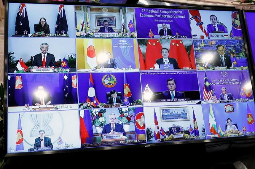 Asean leaders are seen on a screen as they attend the 4th Regional Comprehensive Economic Partnership Summit as part of the 37th ASEAN Summit in Hanoi, Vietnam on Nov 15, 2020.