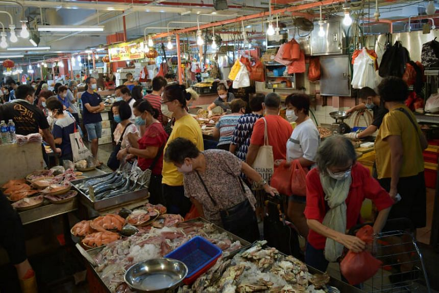 Shoppers thronging the seafood section at Chinatown Wet Market on Feb 2, 2021.