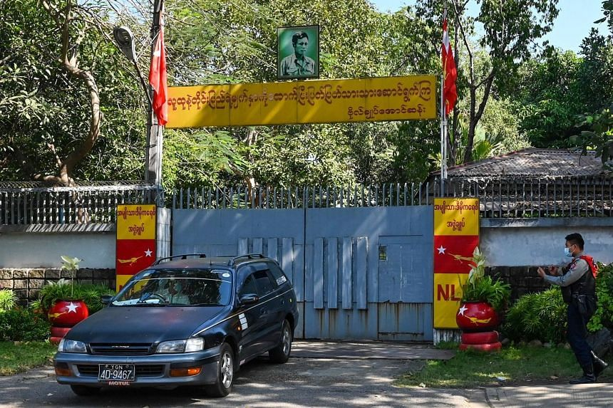 Left: A car leaving the Yangon residence of State Counsellor Aung San Suu Kyi (right) yesterday. Ms Suu Kyi was detained, and replaced as Foreign Minister, after a military coup on Monday. The Myanmar government, under commander-in-chief Min Aung Hla