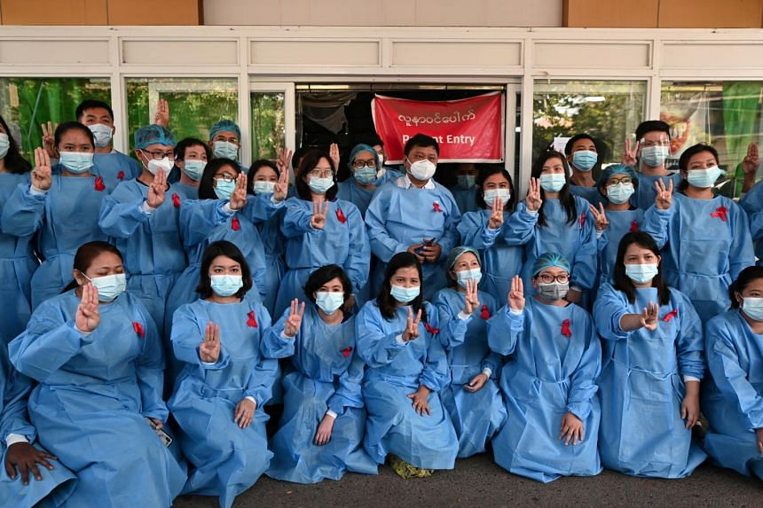 Medical workers during a protest against Myanmar's military coup at Yangon General Hospital on Feb 3, 2021.