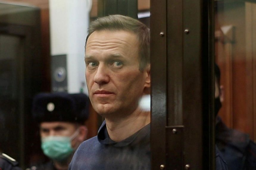 A Moscow court converted a suspended sentence that Alexey Navalny received into a prison term.