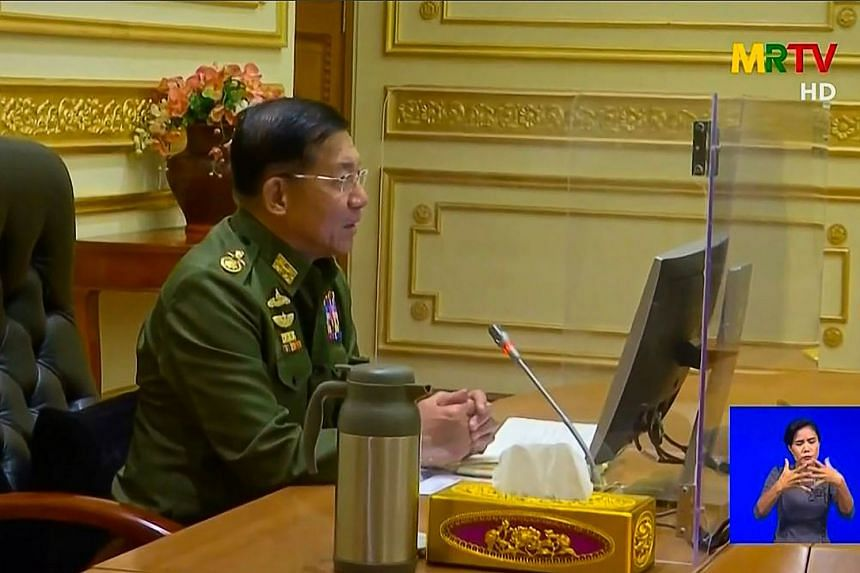 A video screengrab shows shows General Min Aung Hlaing chairing the first Cabinet meeting at the Presidential Palace in Naypyidaw.