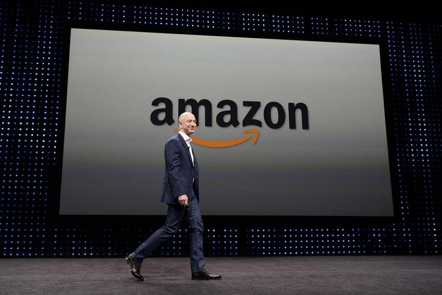 Amazon CEO Jeff Bezos walking on stage at a press conference where he introduced new Kindle products, on Sept 6, 2012.