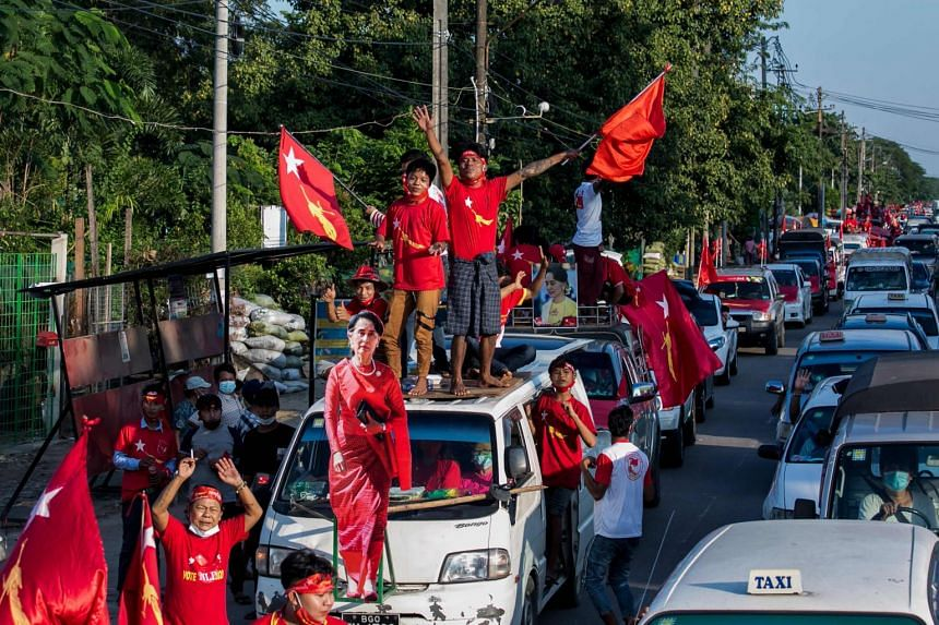 A photo taken on Nov 10, 2020, shows NLD  supporters celebrating with a cut-out figure of Ms Aung San Suu Kyi.