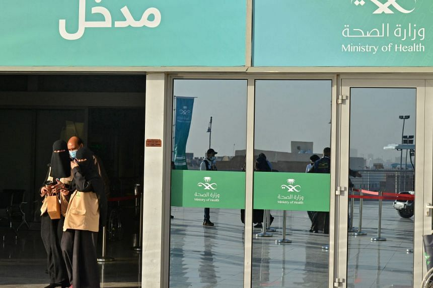 People leave the Riyadh International Convention and Exhibition Centre after receiving coronavirus vaccine shots on Jan 21, 2021.