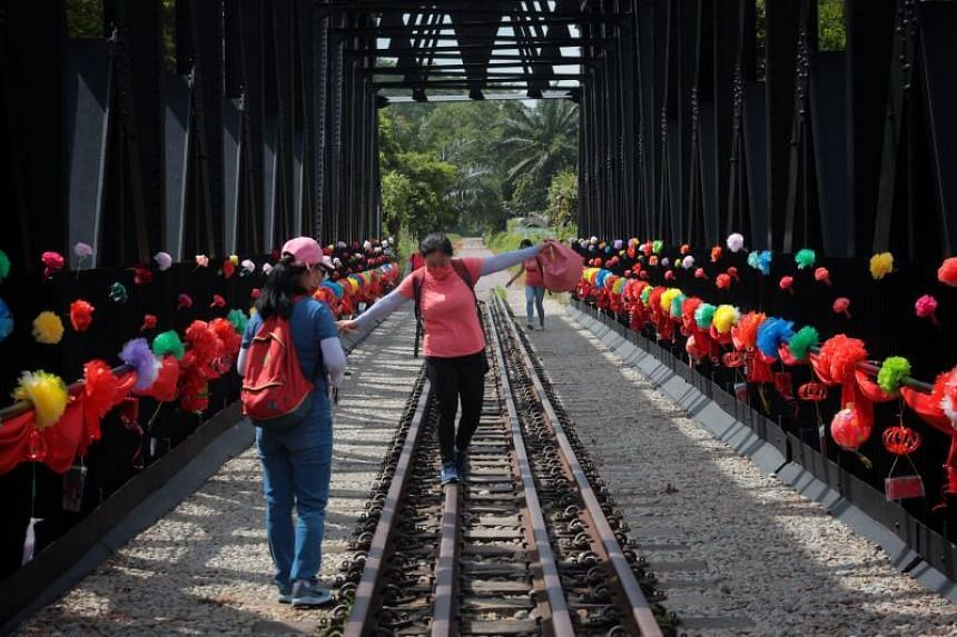 Bukit Timah Truss Bridge adorned with lanterns and flowers handcrafted by volunteers, on Feb 3, 2021.