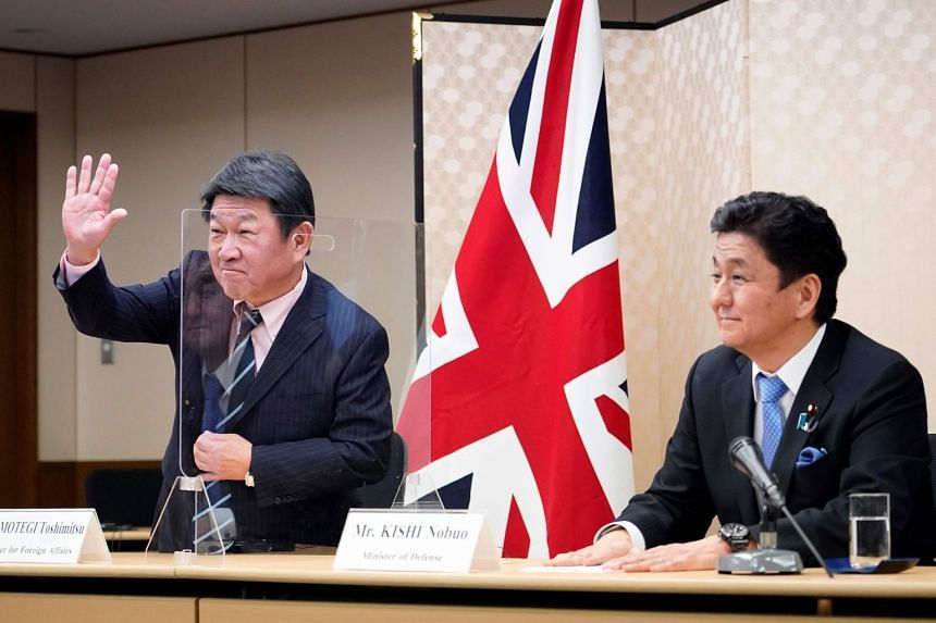 Japan's Foreign Minister Toshimitsu Motegi (left) and Defence Minister Nobuo Kishi attend a video conference with their British counterparts, in Tokyo, on Feb 3, 2021.