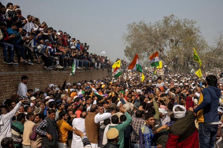 People attend a grand village council meeting as part of a farmers' protest against farm laws in the northern state of Haryana, India, on Feb 3, 2021.