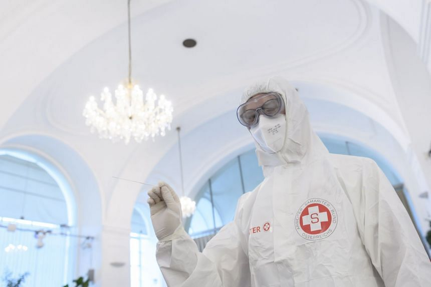 A healthcare worker at a Covid-19 test centre in Vienna, Feb 3, 2021