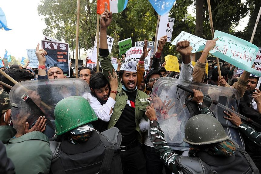 Protesters and security personnel clashing during a demonstration in solidarity with Indian farmers in New Delhi on Wednesday. PHOTO: EPA-EFE