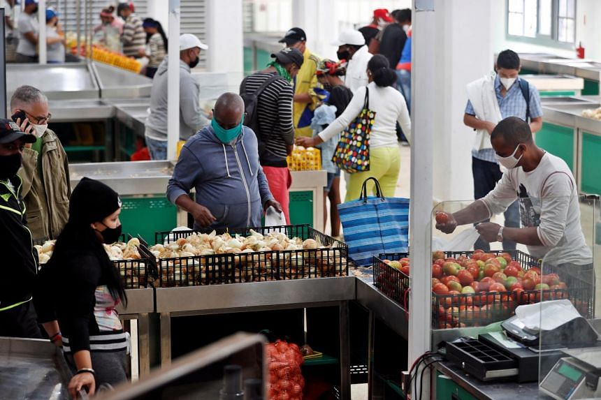 People buying agricultural products in a market in Havana, Cuba, on Feb 2, 2021.